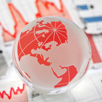 Red and Gray Globe with charts on the table