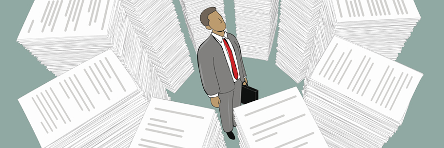 Person surrounded by stack of papers
