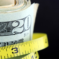 Measuring tape around money