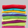 a stack of t shirts
